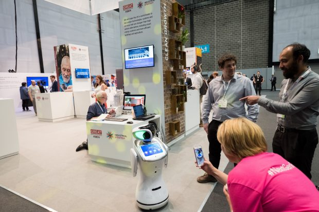 A robot on a stand at the International Business Festival.
