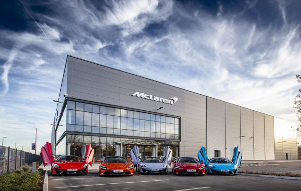 Picture of the newly-opened McLaren Composites Technology Centre in Sheffield with a number of McLaren cars outside on the forecourt.