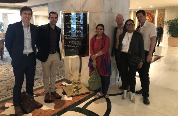 Indian and UK delegation stood in hotel lobby