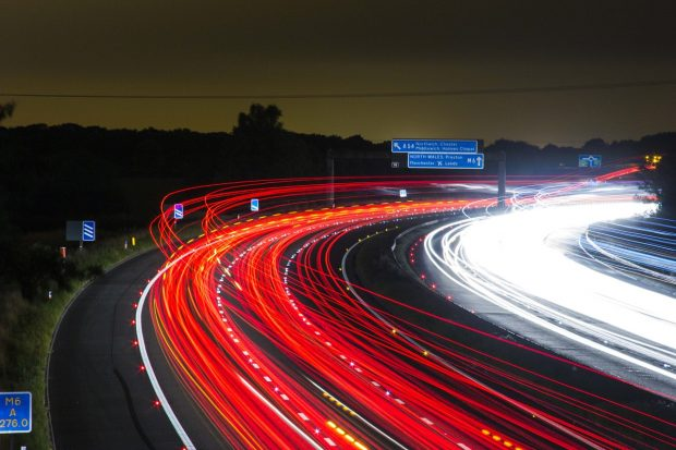 Car taillights on a motorway at night