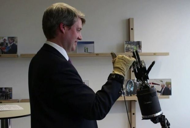 Science Minister Chris Skidmore with a robotic arm at Cranfield University