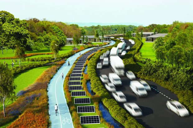 Motorway with roads, solar panels and cycle path running alongside it